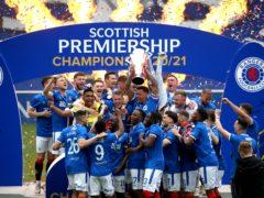 Rangers' James Tavernier lifts the Scottish Premiership trophy (Andrew Milligan/PA)