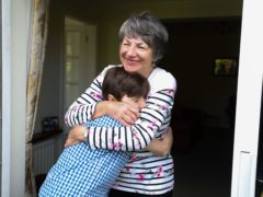 Sue Rickett hugs her grandson Ben for the first time in over a year, as restrictions are finally eased (Martin Rickett/PA)