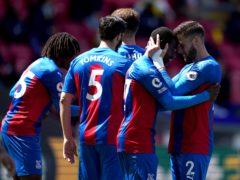 Crystal Palace's Tyrick Mitchell, second right, celebrates scoring (John Walton/PA)