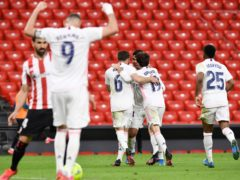 Real Madrid's Karim Benzema, and his team-mates celebrate the first goal (Alvaro Barrientos/AP)