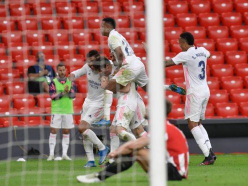 Real Madrid's Nacho, celebrates following his second-half strike (Alvaro Barrientos/AP)