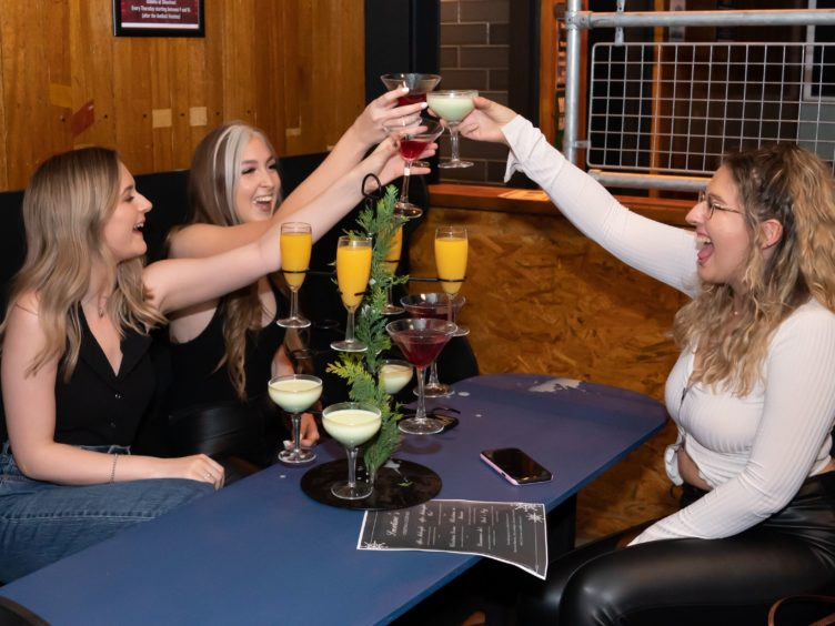 Customers get their first drink at the Showtime Bar in Huddersfield (Danny Lawson/PA)