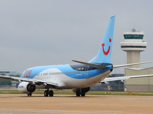 A TUI flight leaves for Funchai, on the Portuguese island of Madeira, from Gatwick Airport (Gareth Fuller/PA)