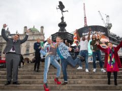 Noah Thomas (front second left), Shane Richie (front centre), Magic Mike stars and Ros Morgan (right), CEO of Heart of London Business Alliance, at Piccadilly Circus (Kirsty O'Connor/PA)