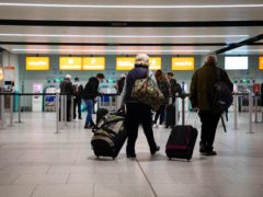 Passengers check in for the first holiday and leisure flight to take-off at Gatwick Airport (David Parry/PA)