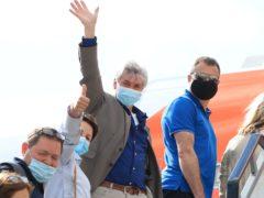 Passengers board an easyJet flight to Faro, Portugal, at Gatwick Airport (Gareth Fuller/PA)