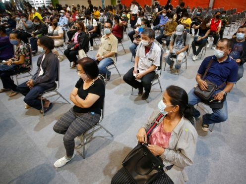 People wait to receive a Covid jab in Bangkok, Thailand (AP/Anuthep Cheysakron)