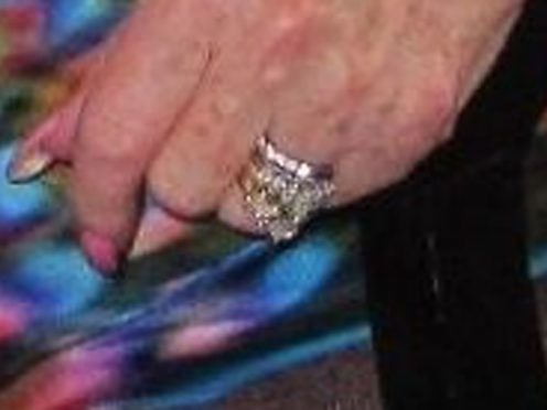 An engagement ring and a wedding ring which were taken from the finger of a woman who had died in hospital (Essex Police/PA)