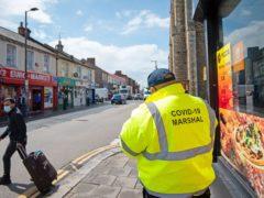A Covid marshal on patrol in Bedford (Joe Giddens/PA)