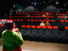 Cinema programme manager Claire Vaughan introduces the film Nomadland to audiences inside a movie theatre screen at Chapter, Cardiff (Ben Birchall/PA)