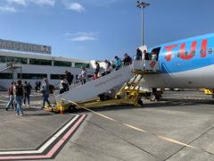 Holidaymakers disembarking from their London Gatwick flight in Madeira on Monday May 17 (PA)