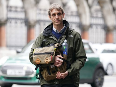 Television presenter Jeremy Stansfield leaving the Royal Courts of Justice (Yui Mok/PA)