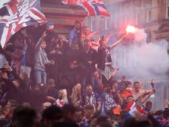 Rangers fans celebrate winning the Scottish Premiership in George Square, Glasgow (Andrew Milligan/PA)