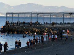 People from Morocco enter the Spanish territory of Ceuta (Antonio Sempere/Europa Press via AP)