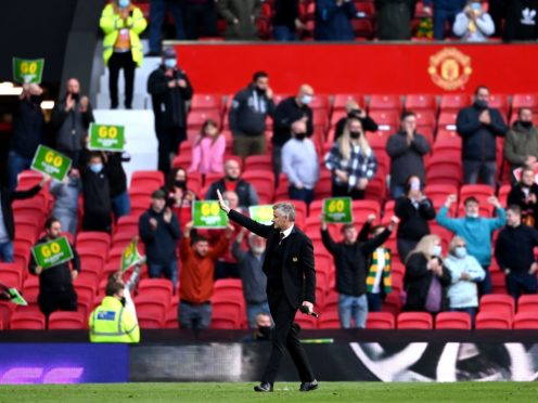 Manchester United manager Ole Gunnar Solskjaer gestures to the returning fans at Old Trafford (Laurence Griffiths/PA)