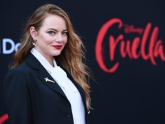 Emma Stone wore black and white as she walked the red carpet for the premiere of Cruella (Jordan Strauss/Invision/AP)