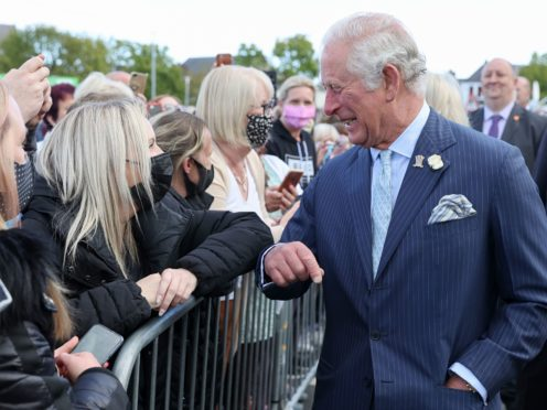 The Prince of Wales elbow-bumps at well-wisher during a visit to Bangor Market (Chris Jackson/PA)