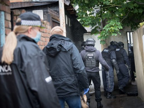 Police during a National Crime Agency operation in east London (Stefan Rousseau/PA)