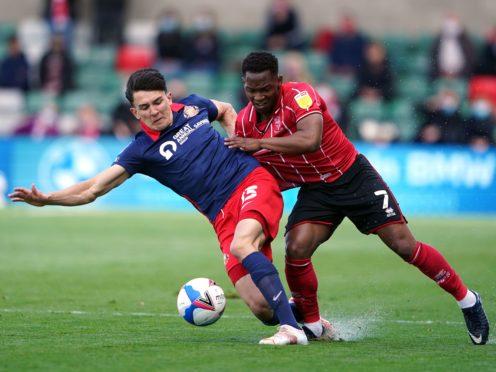 Sunderland's Luke O'Nien (left) and Lincoln's Tayo Edun battle for the ball (Zac Goodwin/PA)