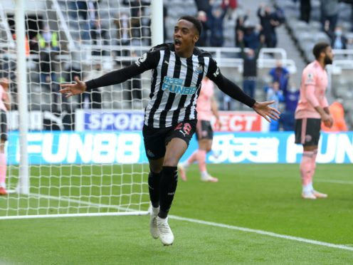 Joe Willock celebrates scoring for a sixth straight game (Stu Forster/PA)