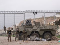 Spanish soldiers have been guarding the border with Morocco (AP Photo/Bernat Armangue)