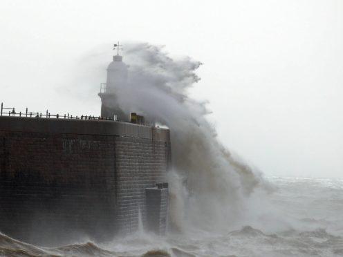 Waves crash against the harbour wall in Folkestone, Kent (Gareth Fuller/PA)