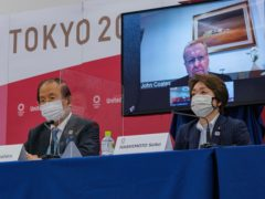 John Coates (on screen) said the Tokyo Olympics would go ahead even if the city was in a state of emergency (Nicolas Datiche/Pool via AP)