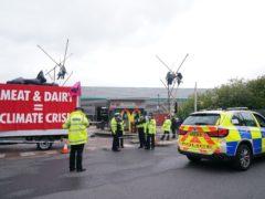 Animal Rebellion protesters outside a McDonald's distribution site in Hemel Hempstead (Yui Mok/PA)