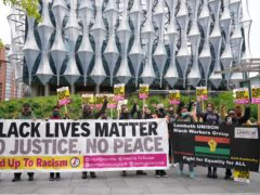 People take part in a BLM protest to commemorate the death of George Floyd outside the US Embassy in London (Yui Mok/PA)