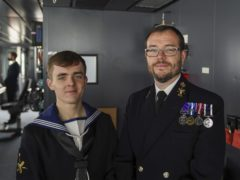 Morgan Brookes (left) and his father, Paul Brookes, after the Queen's visit (Steve Parsons/PA)
