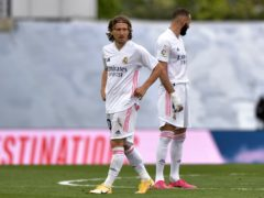 Luka Modric, left, and Karim Benzema scored for Real Madrid but crosstown rivals Atletico won the LaLiga title (Pablo Morano/AP/PA)