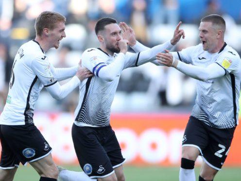 Swansea skipper Matt Grimes (centre) scored the vital goal (Nick Potts/PA)