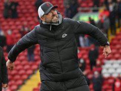 Jurgen Klopp celebrates in front of the Liverpool fans (Paul Ellis/PA)