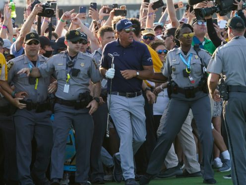 The head of the PGA of America has apologised to champion Phil Mickelson and runner-up Brooks Koepka after they were mobbed by fans on the 18th fairway at the US PGA Championship (Matt York/AP)