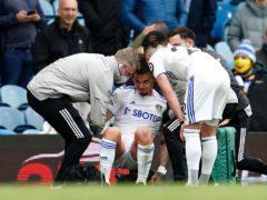 Kalvin Phillips, centre, receives treatment for a shoulder injury (Jon Super/PA)