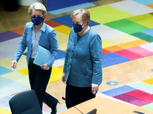 German chancellor Angela Merkel, right, walks with European Commission president Ursula von der Leyen Olivier Matthys/AP)