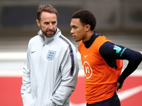 England manager Gareth Southgate, left, speaks with Trent Alexander-Arnold (Tim Goode/PA)