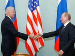 In this March 10 2011 file photo, Joe Biden, left, shakes hands with Vladimir Putin in Moscow, Russia. (Alexander Zemlianichenko/AP)