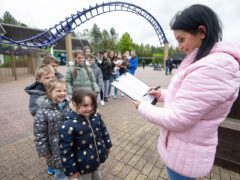 Sue and Noel Radford arrive at Alton Towers Resort with 15 of their children (Jeff Spicer/PA)