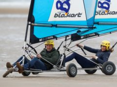 The Duke and Duchess of Cambridge land yachting on the beach at St Andrews (Phil Noble/PA)