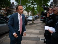 Health Minister Matt Hancock with members of the media outside his home in north west London (Aaron Chown/PA)