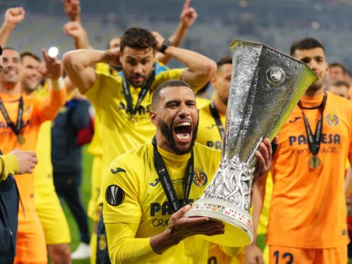 Villareal's Etienne Capoue holds the Europa League trophy (Michael Sohn/AP)