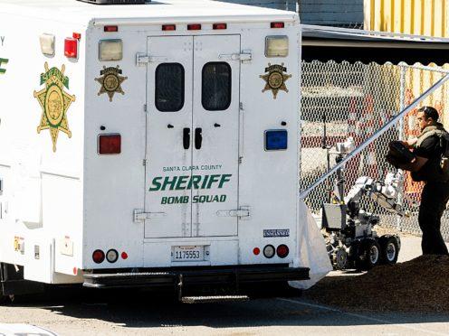 A emergency crew at the scene of the shooting in Santa Clara, California (Noah Berger/AP)