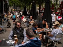 Customers at a terrace bar in Barcelona, Spain (Emilio Morenatti/AP)