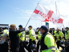 Anti-migrant protester tries to block a road during a demonstration in Dover against immigration and the journeys made by refugees crossing the Channel to Kent (PA)