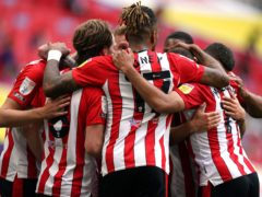 Brentford celebrate their second goal at Wembley from Emiliano Marcondes, hidden (Mike Egerton/PA)