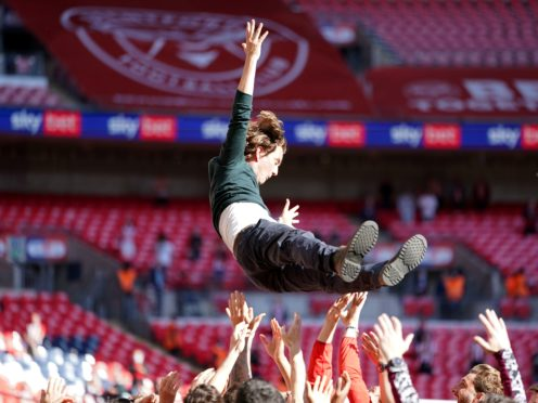 Brentford manager Thomas Frank is tossed into the air by his players as they celebrate promotion (Mike Egerton/PA)