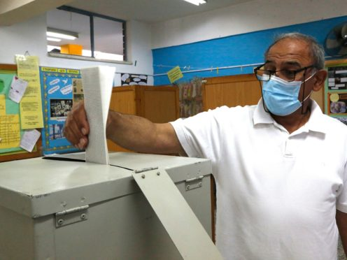 A man casts his vote at a polling station in Deftera, a suburb of the capital Nicosia (Petros Karadjias/AP)