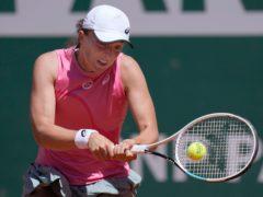 Iga Swiatek beat best friend Kaja Juvan in the first round in Paris (Thibault Camus/AP)