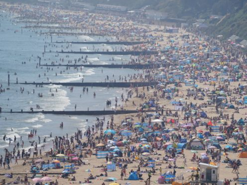 People enjoy the weather on Bournemouth beach in Dorset (Andrew Matthews/PA)